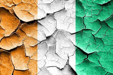 cracks: Grunge Ivory coast flag with some cracks and vintage look