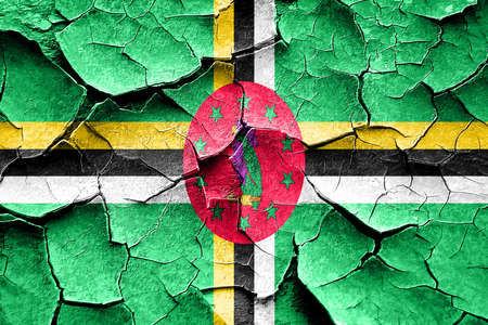 cracks: Grunge Dominica flag with some cracks and vintage look
