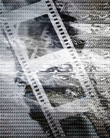 inox: old film strip on a metal plate background