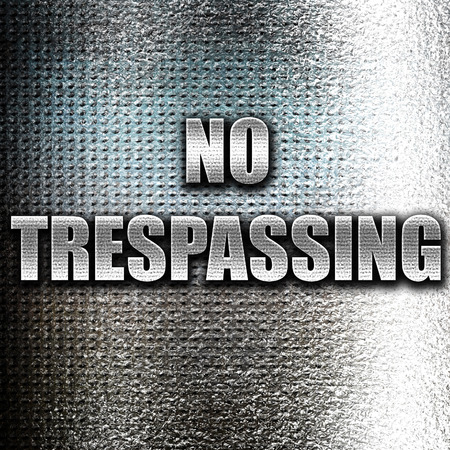 trespassing: Grunge metal No trespassing sign with black and orange colors