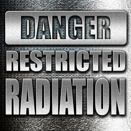 caution chemistry: Grunge metal Nuclear danger background on a grunge background