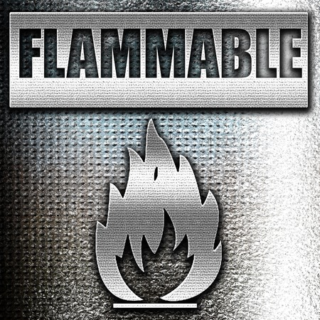 burnable: Grunge metal Flammable hazard sign with yellow and black colors