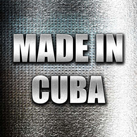commerce and industry: Grunge metal Made in cuba with some soft smooth lines Stock Photo
