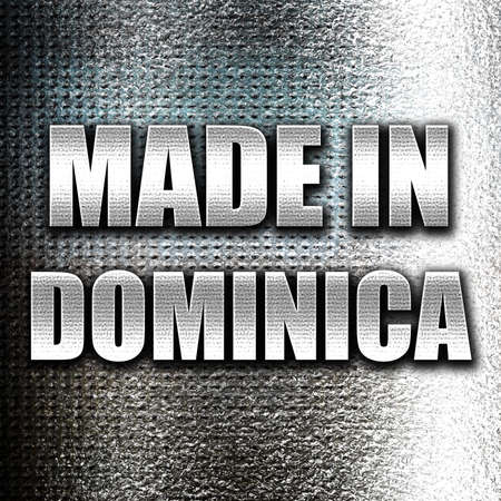 dominica: Grunge metal Made in dominica with some soft smooth lines Stock Photo