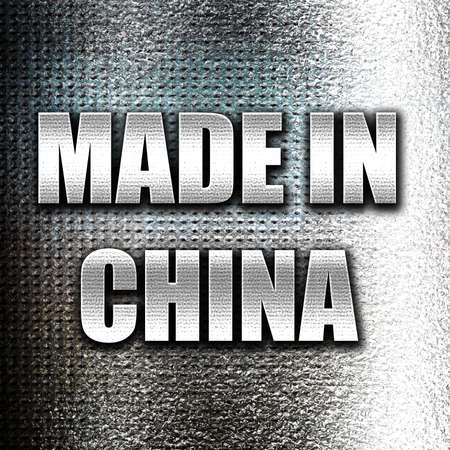 made in china: Grunge metal Made in china with some soft smooth lines Stock Photo