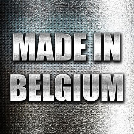 made in belgium: Grunge metal Made in belgium with some soft smooth lines Stock Photo