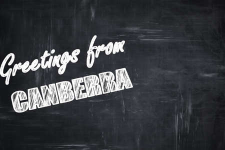 Canberra: Chalkboard background with white letters: Chalkboard background with white letters: Greetings from canberra with some smooth lines
