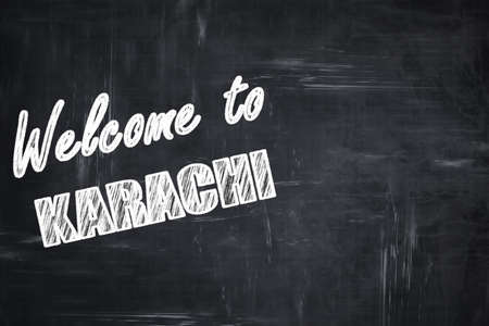 karachi: Chalkboard background with white letters: Chalkboard background with white letters: Welcome to karachi with some smooth lines Stock Photo