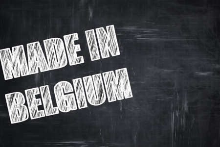 made in belgium: Chalkboard background with white letters: Chalkboard background with white letters: Made in belgium with some soft smooth lines Stock Photo