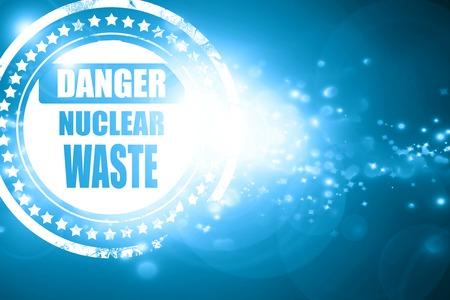 hazardous waste: Glittering blue stamp: Nuclear danger background on a grunge background Stock Photo