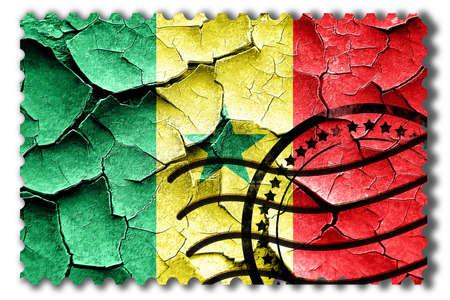 postal stamp: Postal stamp: Grunge Senegal flag with some cracks and vintage look