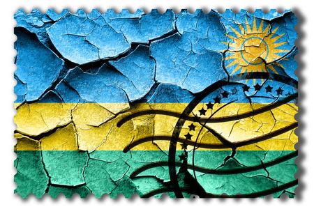 postal stamp: Postal stamp: Grunge Rwanda flag with some cracks and vintage look