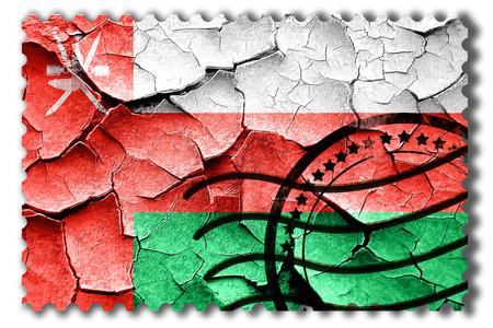 postal stamp: Postal stamp: Grunge Oman flag with some cracks and vintage look