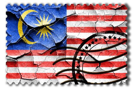 postal stamp: Postal stamp: Grunge Malaysia flag with some cracks and vintage look Stock Photo