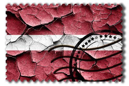 vintage look: Postal stamp: Grunge Latvia flag with some cracks and vintage look Stock Photo