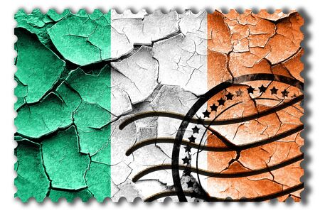 cracks: Postal stamp: Grunge Irealand flag with some cracks and vintage look