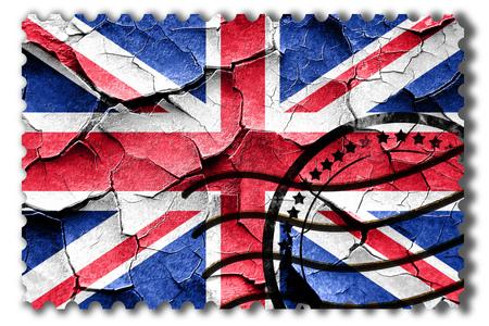 Sello postal: Grunge bandera de Gran Bretaña con algunas grietas y mirada de la vendimia Foto de archivo - 54876259