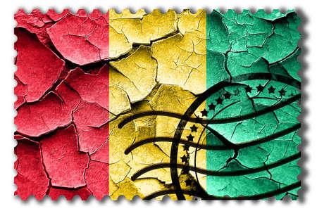 postal stamp: Postal stamp: Grunge Guinea flag with some cracks and vintage look Stock Photo