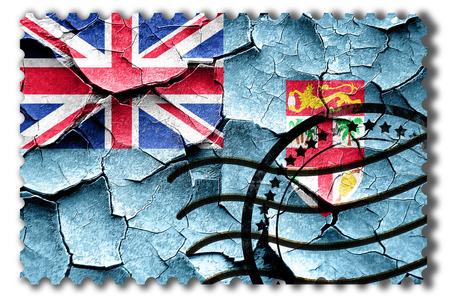 vintage look: Postal stamp: Grunge Fiji flag with some cracks and vintage look