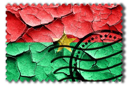 postal stamp: Postal stamp: Grunge Burkina Faso flag with some cracks and vintage look