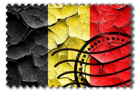 postal stamp: Postal stamp: Grunge Belgium flag with some cracks and vintage look Stock Photo