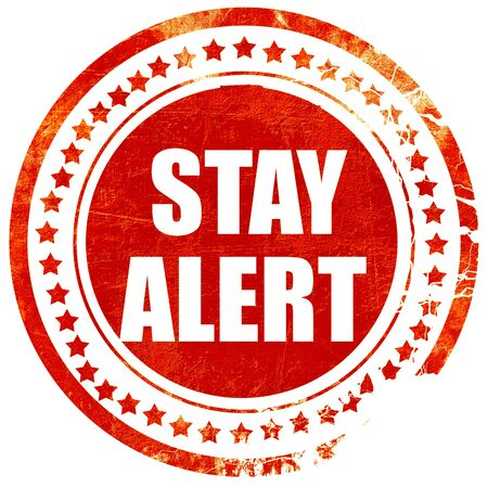safety slogan: stay alert, isolated red rubber stamp on a solid white background Stock Photo