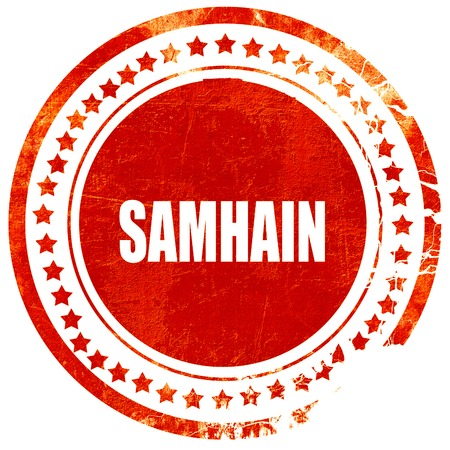 Traditional glowing Samhain Jack-o-Lantern with carved word Samhain on it. Pagan Wiccan Wheel of the Year holiday celebration., isolated red rubber stamp on a solid white background Stock Photo