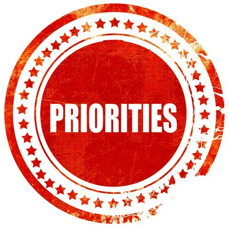 priorities: priorities, isolated red rubber stamp on a solid white background
