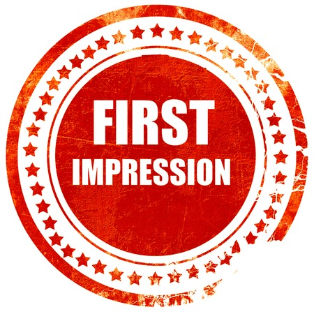 first impression, isolated red rubber stamp on a solid white background Reklamní fotografie
