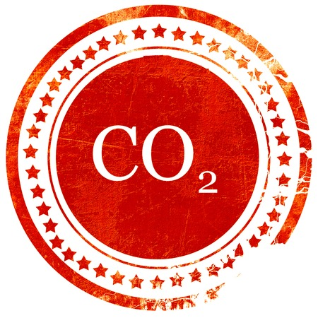 carbon emission: CO2 warning sign with yellow and black colors, isolated red rubber stamp on a solid white background