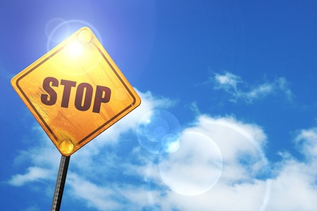 slow down: stop: yellow road sign with a blue sky and white clouds