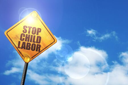 illegality: stop child labor: yellow road sign with a blue sky and white clouds