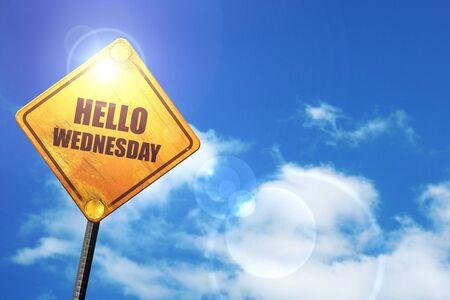 wednesday: hello wednesday: yellow road sign with a blue sky and white clouds