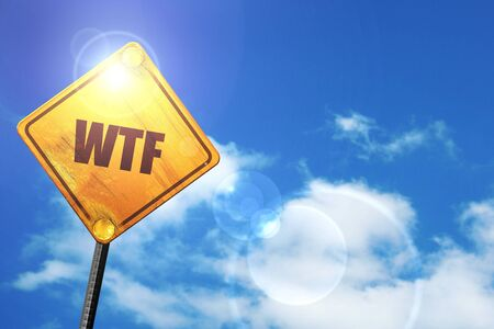 wtf: wtf internet slang with some soft smooth lines: yellow road sign with a blue sky and white clouds Stock Photo