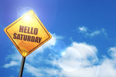saturday: hello saturday: yellow road sign with a blue sky and white clouds