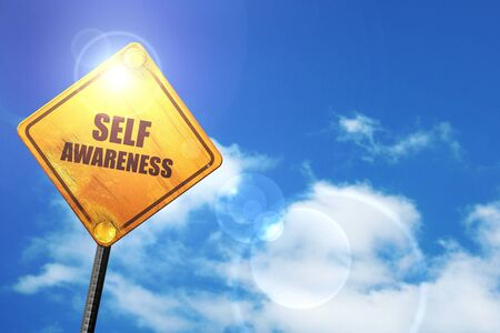self worth: self awareness: yellow road sign with a blue sky and white clouds