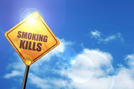 killing cancer: smoking kills: yellow road sign with a blue sky and white clouds