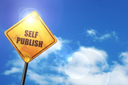 self publishing: yellow road sign with a blue sky and white clouds Stock Photo
