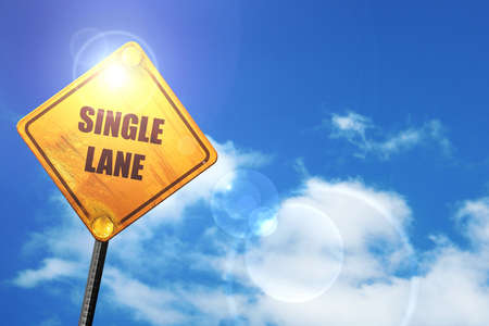 one lane street sign: Single lane sign with yellow and black colors: yellow road sign with a blue sky and white clouds