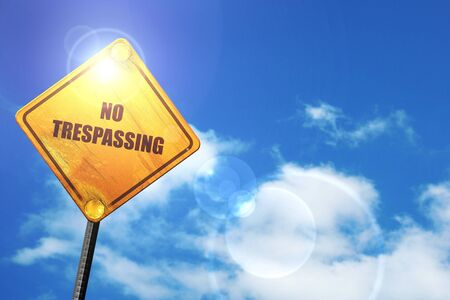 trespassing: No trespassing sign with black and orange colors: yellow road sign with a blue sky and white clouds