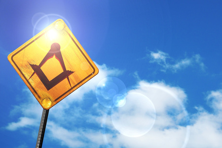 freemasonry: Masonic freemasonry symbol with some soft smooth lines: yellow road sign with a blue sky and white clouds Stock Photo