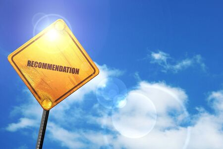 recommendation: recommendation: yellow road sign with a blue sky and white clouds Stock Photo