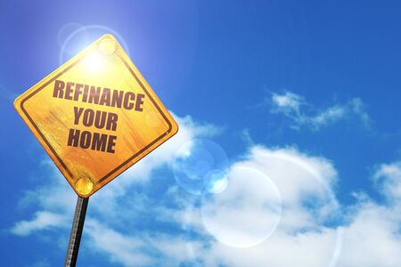 refinancing interest rates: refinance your home: yellow road sign with a blue sky and white clouds