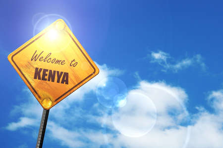 trip hazard sign: Welcome to kenya card with some soft highlights: yellow road sign with a blue sky and white clouds