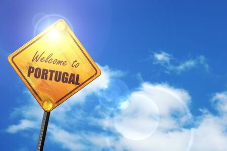 trip hazard sign: Welcome to portugal card with some soft highlights: yellow road sign with a blue sky and white clouds