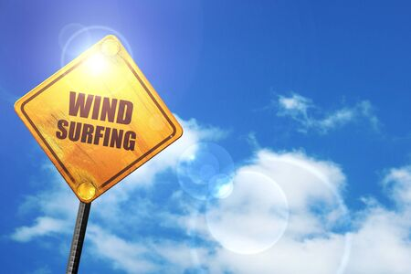 wind surfing: wind surfing sign background with some soft smooth lines: yellow road sign with a blue sky and white clouds Stock Photo