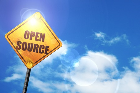 software portability: open source: yellow road sign with a blue sky and white clouds Stock Photo