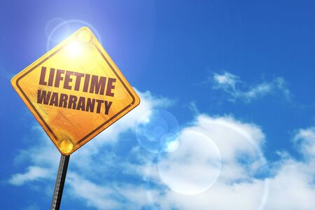 lifetime: lifetime warranty: yellow road sign with a blue sky and white clouds