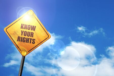 know your rights: yellow road sign with a blue sky and white clouds