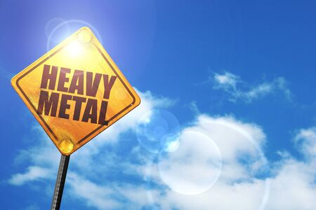 heavy metal music: heavy metal music: yellow road sign with a blue sky and white clouds Stock Photo